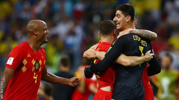 Thibaut Courtois celebrates with team-mates