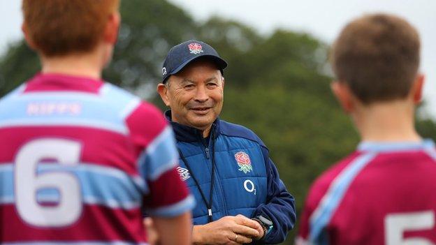 England's head coach Eddie Jones trains young players