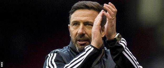 Aberdeen manager Derek McInnes applauds fans after the win over Kilmarnock