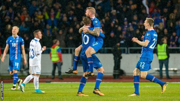 Gylfi Sigurdsson celebrates an Iceland goal on the night they secured qualification