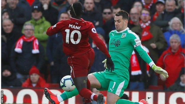 Sadio Mane goes round Tom Heaton before scoring Liverpool's fourth goal