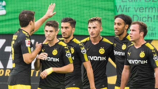 Dortmund players celebrate Christian Pulisic's opening goal