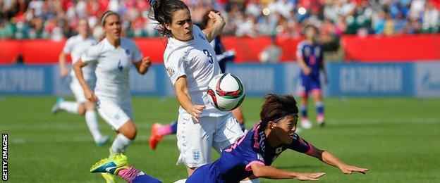 Claire Rafferty of England fouls Saori Ariyoshi of Japan to concede a penalty