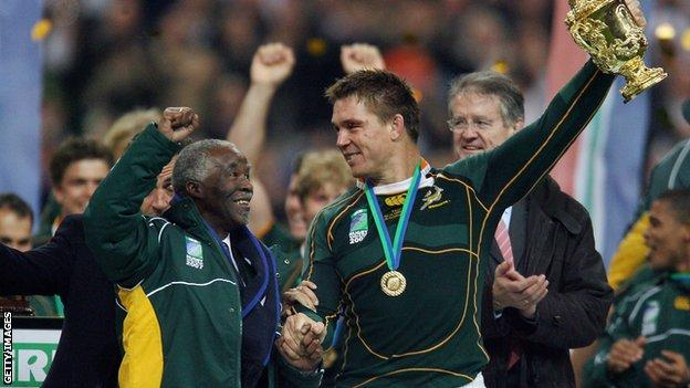 South Africa captain Smit receives the World Cup trophy with Thabo Mbeki