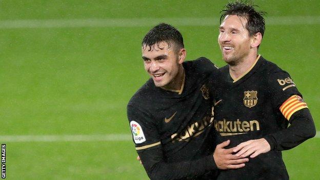 Pedri and Lionel Messi