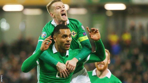 Northern Ireland's Josh Magennis and Steven Davis celebrate