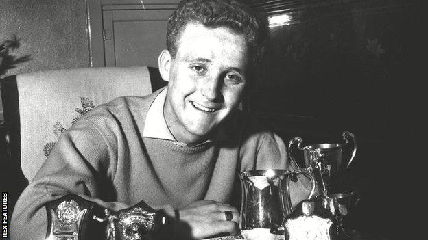 Alex Young with his Hearts trophies