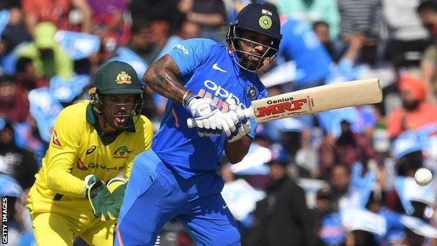 Australia wicketkeeper Alex Carey and India batsman Shikhar Dhawan