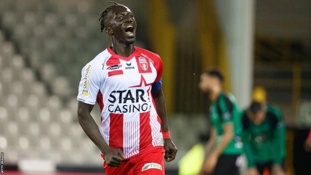 Mbaye Leye celebrates a goal for Belgian club Royal Excel Mouscron in 2019