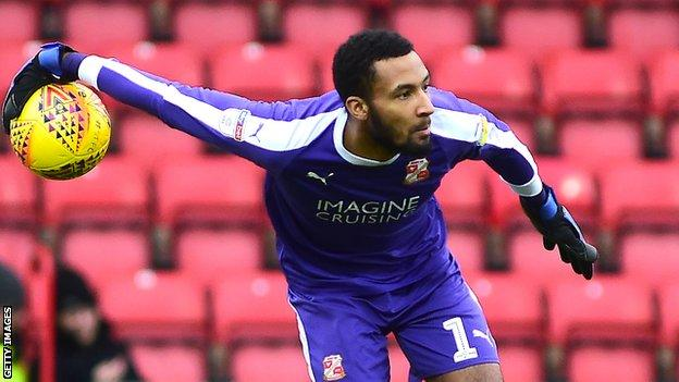Lawrence Vigouroux in action for Swindon Town