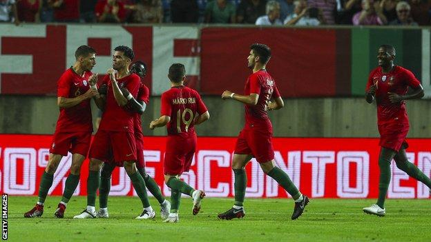 Pepe is congratulated after scoring for Portugal