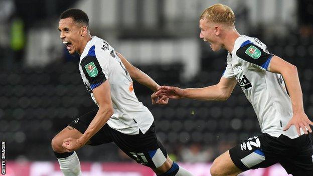Ravel Morrison celebrates scoring for Derby County against Salford City