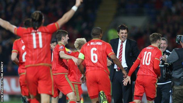 Wales players and manager Chris Coleman celebrate against Andorra