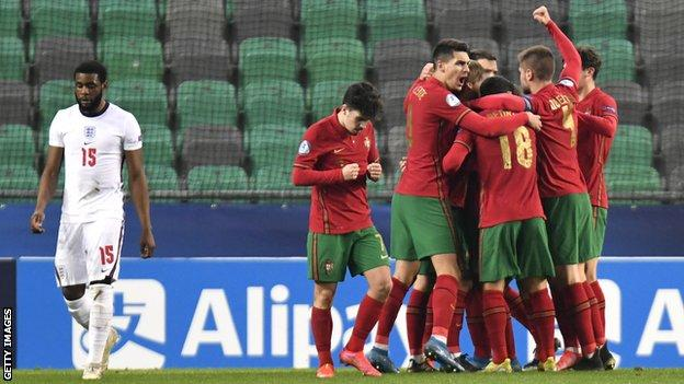The Portuguese players celebrate Dany Mote's opening goal