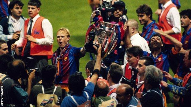 Ronald Koeman holds the European Cup as a Barcelona player