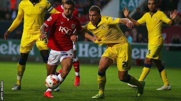 Ryan Fredericks of Bristol City battles with Charlie Taylor of Leeds United