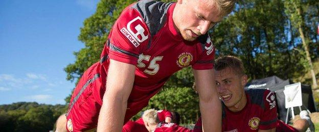 Crewe players Stephen Kingsley and George Ray take part in press-ups on a team bonding day in the Lake District