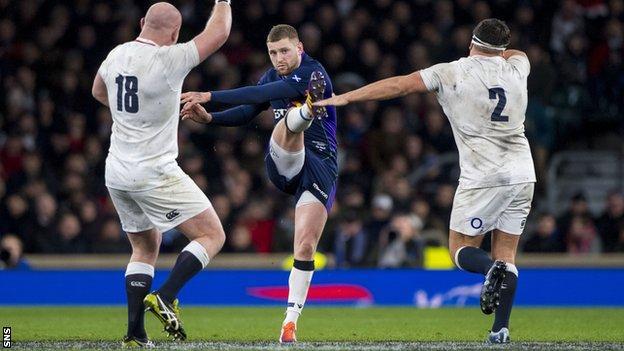 Scotland fly-half Finn Russell kicks against England