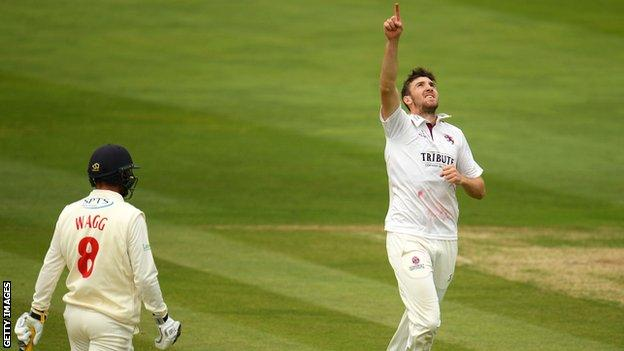Craig Overton celebrates after claiming the wicket of Graham Wagg