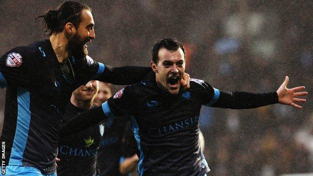 Ross Wallace (right) celebrates his first-half goal