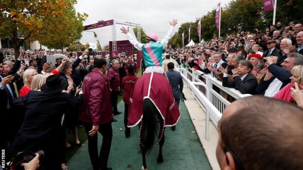 Frankie Dettori is congratulated by the crowd after finishing