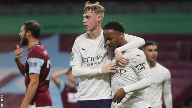 Cole Palmer and Raheem Sterling celebrate a Manchester City goal against Burnley in the Carabao Cup