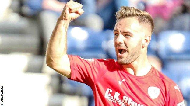 Adam Armstrong celebrates his goal for Barnsley