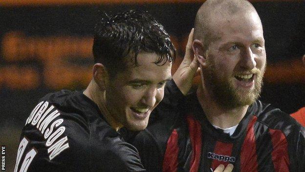 Joshua Robinson congratulates Crusaders scorer Stephen O'Flynn