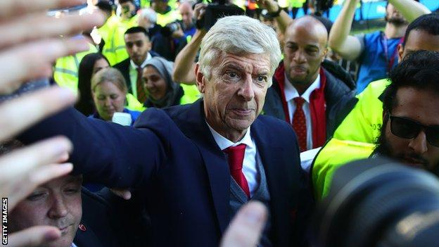 Arsene Wenger greets fans following his last game in charge of Arsenal in May 2018