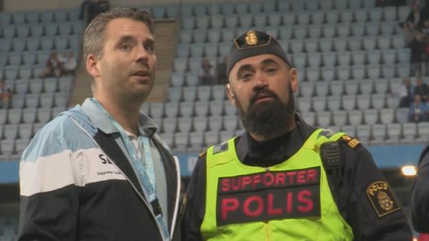 The Malmo supporter liaison officer Pierre Nordberg and policeman Gorgin Shoai
