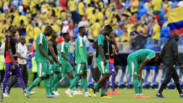 Senegal players exit the pitch
