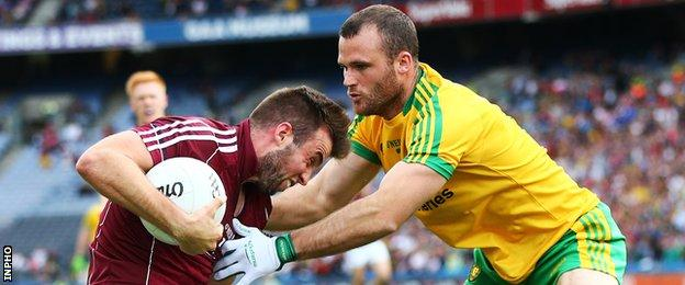 Donegal defender Neil McGee challenges Galway's Paul Conroy