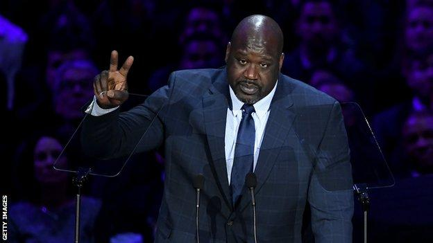 Former Los Angeles Lakers star Shaquille O'Neal raises a peace sign after giving a speech in memory of former team-mate Kobe Bryant