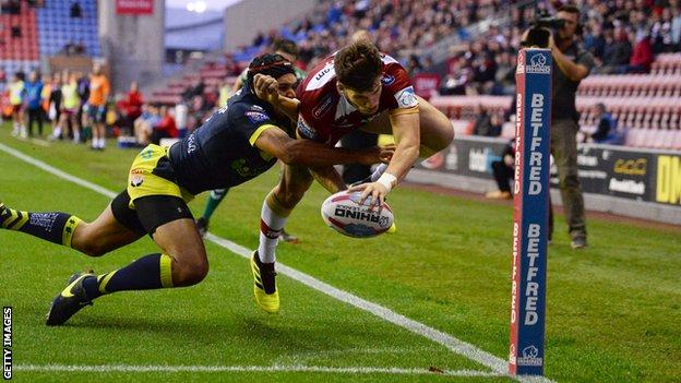 Oliver Gildart scores Wigan's first try