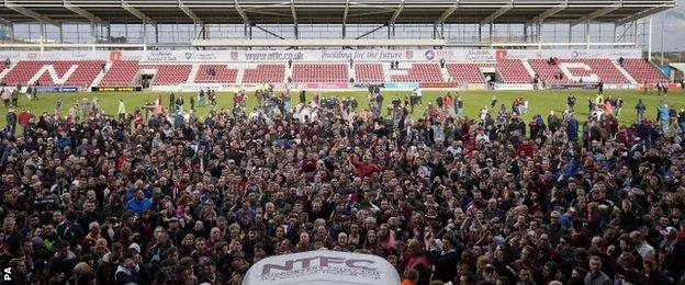 Northampton fans ran onto the pitch at the final whistle
