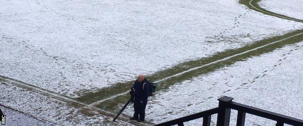Snow covers the Somerset Park pitch