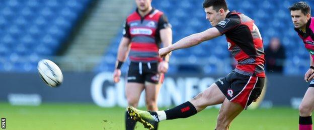 Blair Kinghorn kicks at goal for Edinburgh against Scarlets