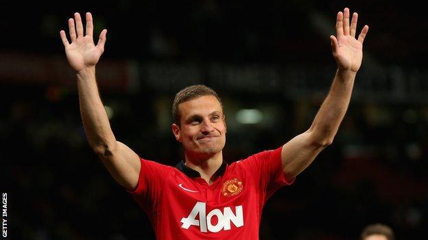 Nemanja Vidic waving to the Manchester United fans