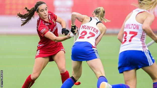 Belgium's Tiphaine Duquesne and Britain's Jo Hunter fight for the ball