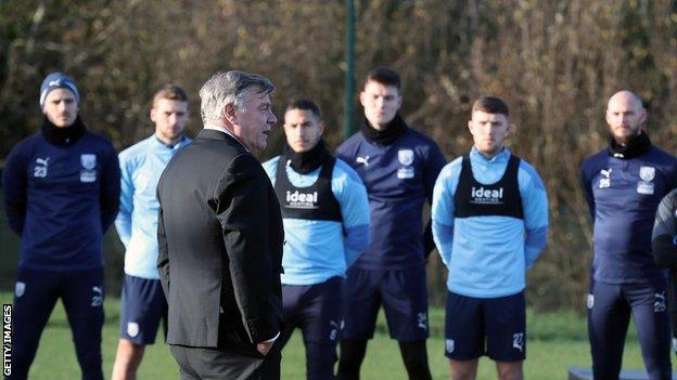 West Brom manager Sam Allardyce speaks to his players