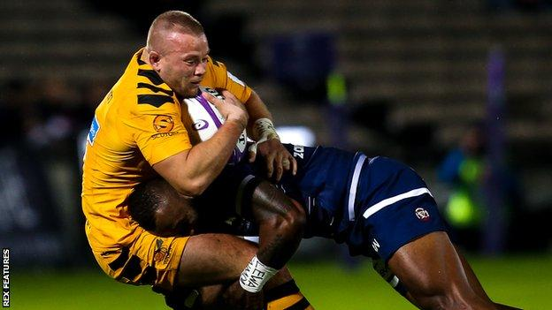 Tom Cruse of Wasps is tackled in his side's defeat against Bordeaux