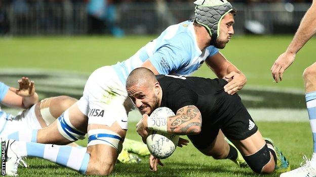 TJ Perenara (centre) scores a try for New Zealand against Argentina