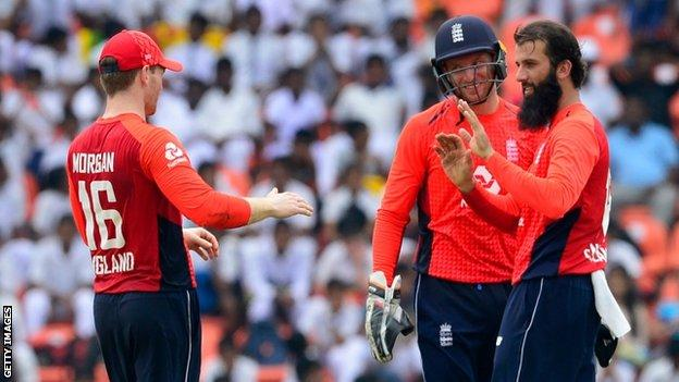 Eoin Morgan, Jos Buttler and Moeen Ali celebrate after the latter takes a wicket in England's victory over Sri Lanka