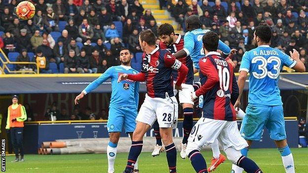 Bologna defender Luca Rossettini scores against Napoli
