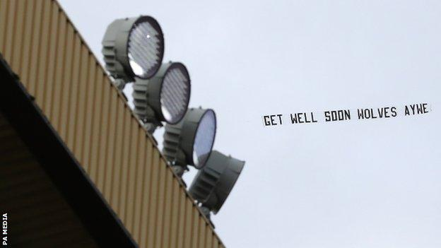 Wolves banner with a 'get well soon' message for Raul Jimenez