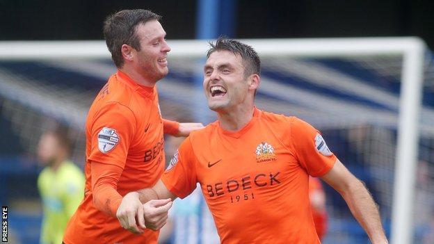 Kevin Braniff congratulates Eoin Bradley