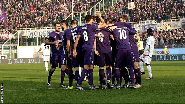 Fiorentina's players celebrate scoring against Udinese