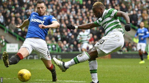 Danny Wilson tries to block Moussa Dembele