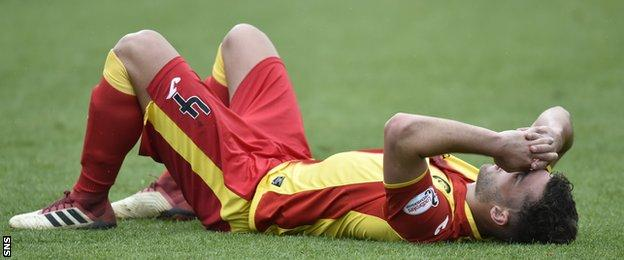 Bailly Cargill is dejected after Partick Thistle suffer relegation