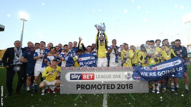 Blackburn players celebrate promotion in 2017-18
